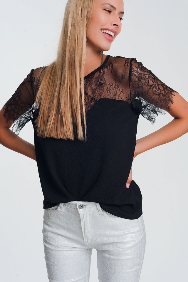 Black shirt with flowers in lace