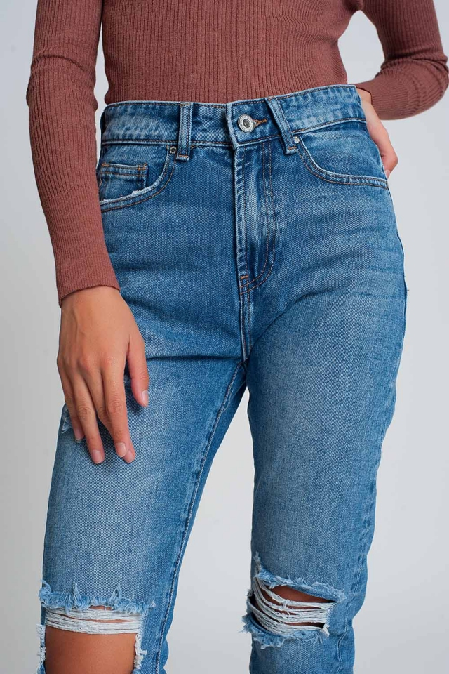 High waist mom jeans with ripped knees in dark wash blue