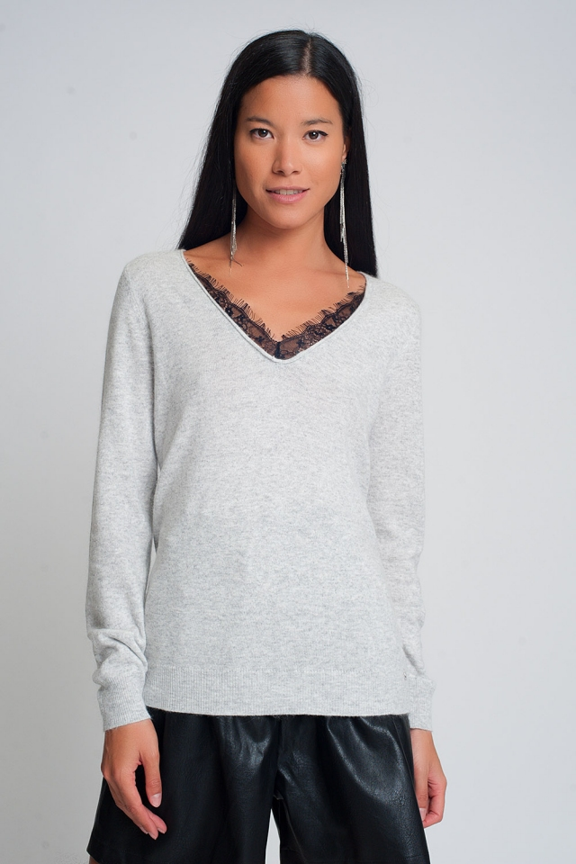 Gray sweater with lace detail and V-neck