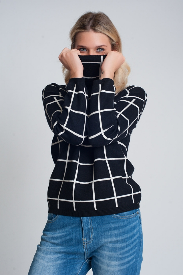 Checkered black turtleneck sweater