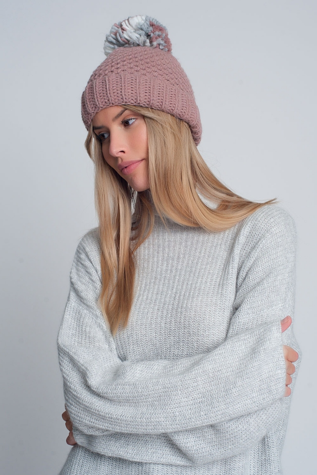 Textured knitted hat with yarn pom in pink